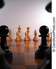 Viewing The Enemy - View of white chess pieces from behind...