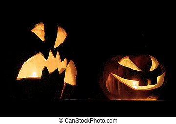 Helloween Kind and malicious pumpkins luminous in a gloom,...