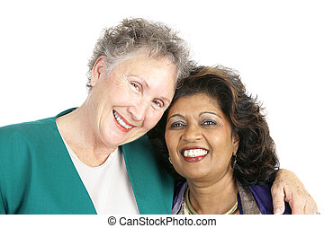 Diverse Friendship - Two women of different ethnicities who...