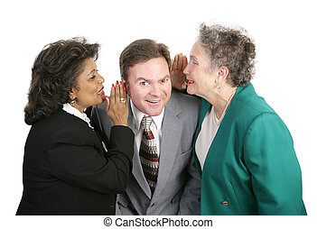 Spreading Office Rumors - Two women whispering office gossip...