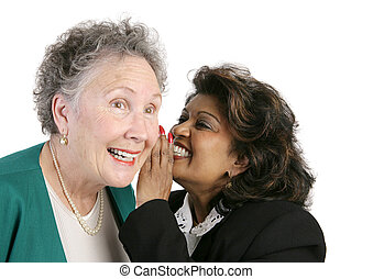 Workplace Gossip - Two businesswomen gossiping and trading...