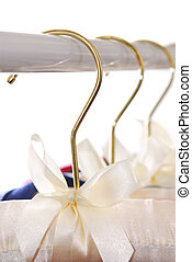 Hangers - Luxury padded dress hangers on a clothes rack