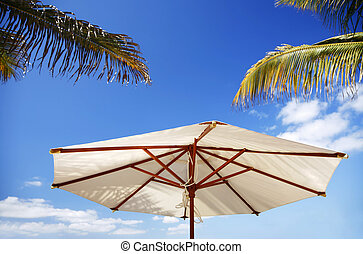 Tropical Summer - White parasol with palm leaves and shadows
