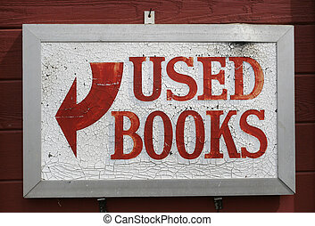 Used Books - Used books weathered signage hanging on red...