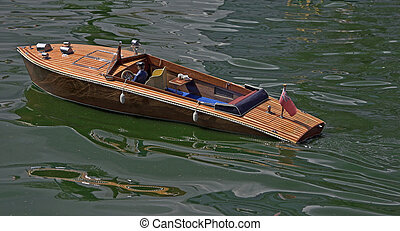 Model Boat - A radio controlled model baot on the water