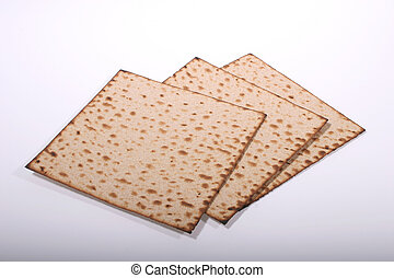 Matzah - Three matzah breads on a white background