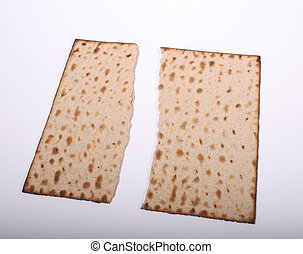 Matzah Halves - A matzah bread broken down the middle on a...