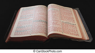 old Bible with red text - an old bible with tattered edges...