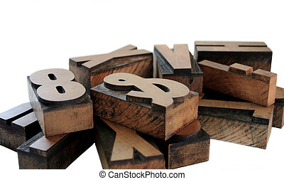 wood letters 1 - old wood letters in a grouping isolated on...