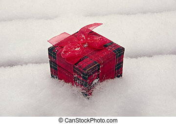 Gift In The Snow - a gift box sitting out in the white...