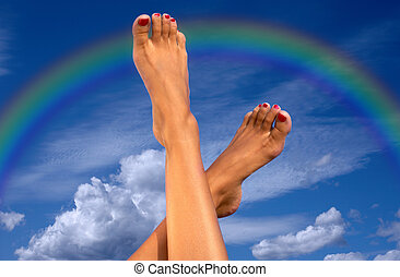 legs over sky with clouds and rainbow - female legs over...
