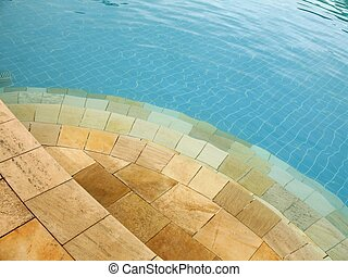 Swimming pool - 5 - Yellow stone steps leading into a blue...