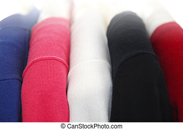 Sweaters - Colorful womens sweaters on a rack on padded...