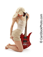 girl in mask with red guitar over white