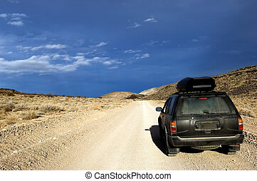 Offroad Adventure - 4x4 SUV on unpaved desert road in Death...