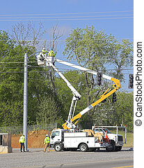 Traffic lights installed 1 - Electric company is installing...