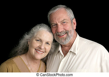 Mature Couple on Black - A good looking silver haired mature...