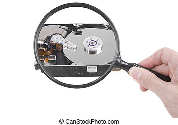Hard drive magnification - Holding a magnifying glass over a...