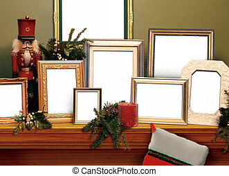 Christmas Frames - A mantel or shelf, decorated for the...