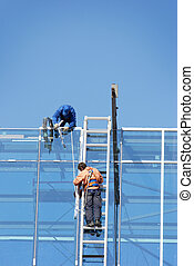workers on height - focus point on men, special vignetting...