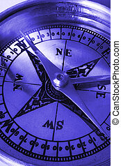 Compass macro in blue - Brass compass with the needle...