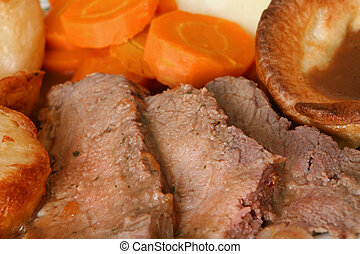Roast beef and Yorkshire pudding, roast and boiled potatoes,...
