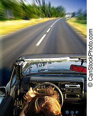 Speeding in Golf cabrio - Man driving fast in vw gol cabrio...