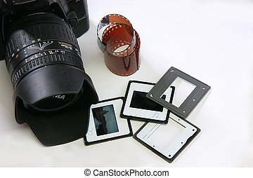 PHOTO EQUIPMENT - Camera, 35 mm film and slides on white...