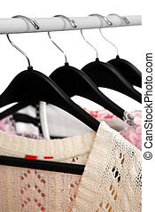 Clothes - Womens clothing on a rack on black hangers