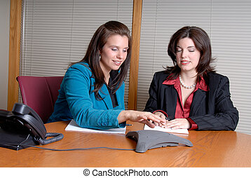 Conference Call Meeting - Two Young Businesswoman Taking...