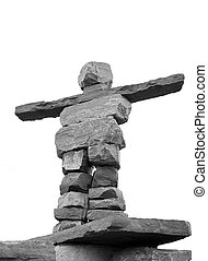 inukshuk - A tall inukshuk isolated.