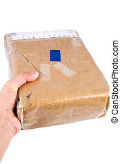 holding brown paper package - a brown paper package close up...