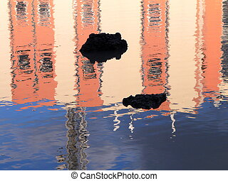 Reflection of pink wall in the puddle
