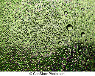 Green stained glass - Drops of dew on the green stained...