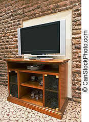 modern TV - The modern TV on a background of a stone wall