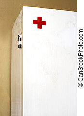 The first-aid set on a brown wall