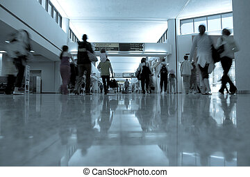 Airport - Departuture area of airport with people moving to...