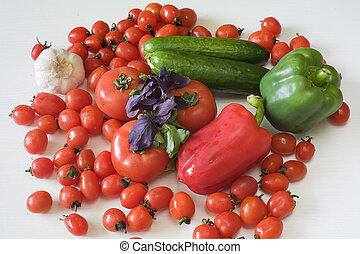 vegetarianism - different red green vegetables lie on the...