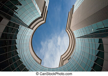 modern building - circle of modern building and blue sky...