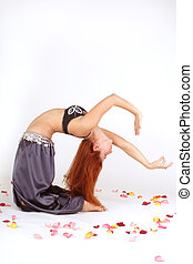 bending bellydancer - Beautiful red-haired oriental dancer...