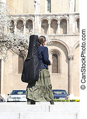 young musician - carrying her instrument