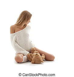 lovely blond in white sweater with teddy bear - picture of...