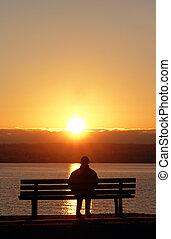 calmo, pôr do sol