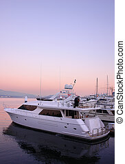 Sunset Boat - Boat in harbour with pink sunset