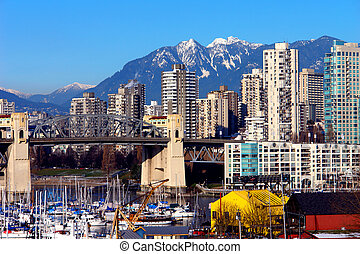 Vancouver - City of Vancouver with mountains in the...