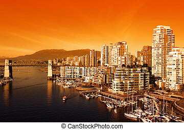 Vancouver Sunset - Bright Orange Sunset over the city of...