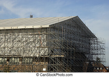 Scaffolding around a big industrial unit in the UK