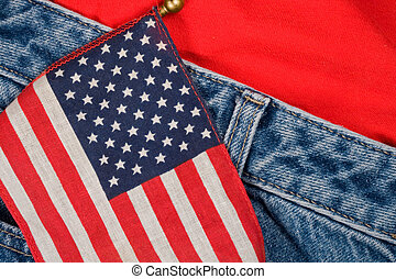 American Flag and Jeans - A small American flag against a...