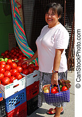 Buying vegetables - Attractive mature woman buying...