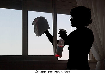Ventana y Silueta_3450. - Woman\\\'s silhouette cleaning the...